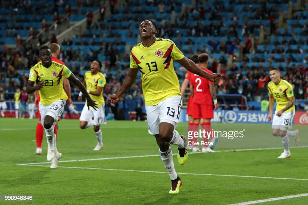 Yerry Mina of Colombia celebrates after scoring his team's first goal during the 2018 FIFA World Cup Russia Round of 16 match between Colombia and...
