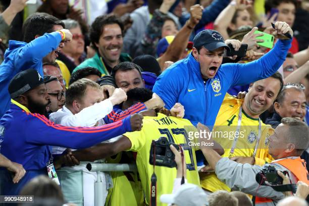 Yerry Mina of Colombia celebrates with fans after scoring his team's first goal during the 2018 FIFA World Cup Russia Round of 16 match between...
