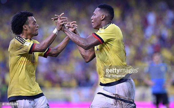 Yerry Mina of Colombia celebrates with Juan Guillermo Cuadrado after scoring the second goal of his team during a match between Colombia and Uruguay...