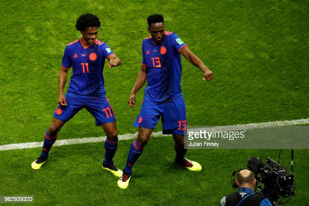 Yerry Mina of Colombia celebrates with teammate Juan Cuadrado after scoring his team's first goal during the 2018 FIFA World Cup Russia group H match...