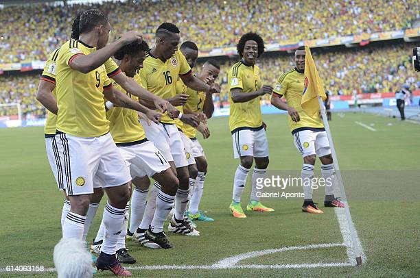 Yerry Mina of Colombia celebrates with teammates after a goal scored by Abel Aguilar of his team during a match between Colombia and Uruguay as part...