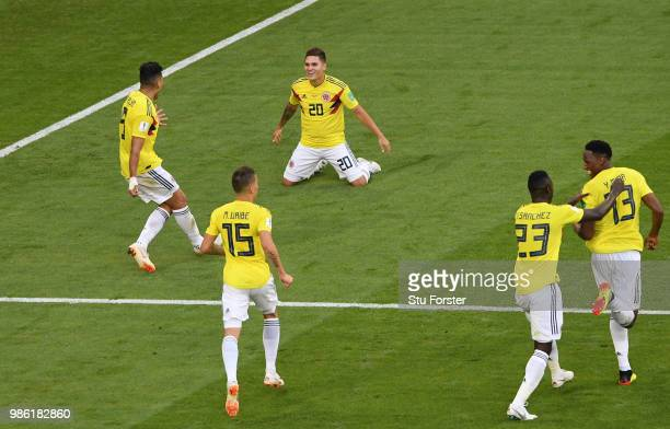 Yerry Mina of Colombia celebrates with teammates after scoring his team's first goal during the 2018 FIFA World Cup Russia group H match between...