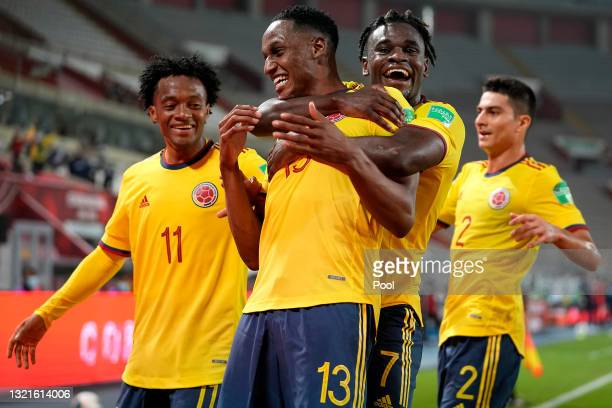 Yerry Mina of Colombia celebrates with teammates Duván Zapata and Juan Cuadrado after scoring the first goal of his team during a match between Peru...