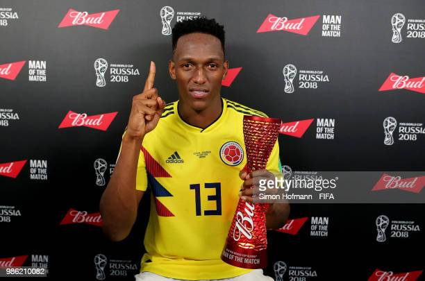 Yerry Mina of Colombia poses with his Man of the Match trophy following his performance in the 2018 FIFA World Cup Russia group H match between...