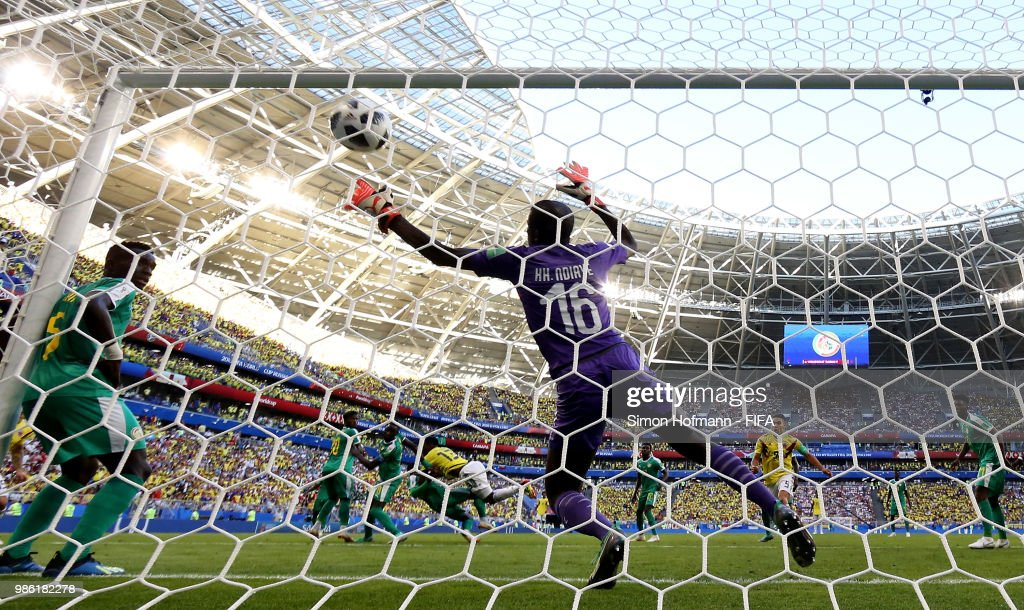 Yerry Mina of Colombia scores his team's first goal past Khadim Ndiaye of Senegal during the 2018 FIFA World Cup Russia group H match between Senegal and Colombia at Samara Arena on June 28, 2018 in Samara, Russia.