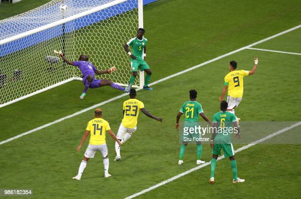 Yerry Mina of Colombia scores his team's first goal past Khadim Ndiaye of Senegal as Radamel Falcao Davinson Sanchez start to celebrate during the...