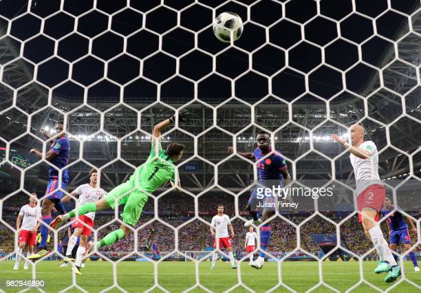 Yerry Mina of Colombia scores his team's first goal past Wojciech Szczesny of Poland during the 2018 FIFA World Cup Russia group H match between...