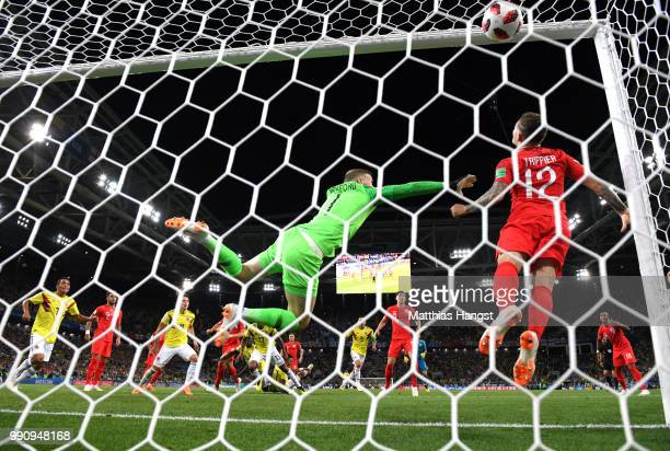 Yerry Mina of Colombia scores past Jordan Pickford of England his team's first goal during the 2018 FIFA World Cup Russia Round of 16 match between...