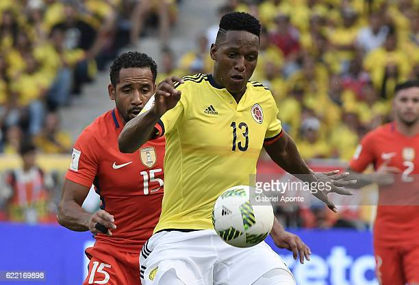 Yerry Mina of Colombia struggles for the ball with Jean Beausejour of Chile during a match between Colombia and Chile as part of FIFA 2018 World Cup...