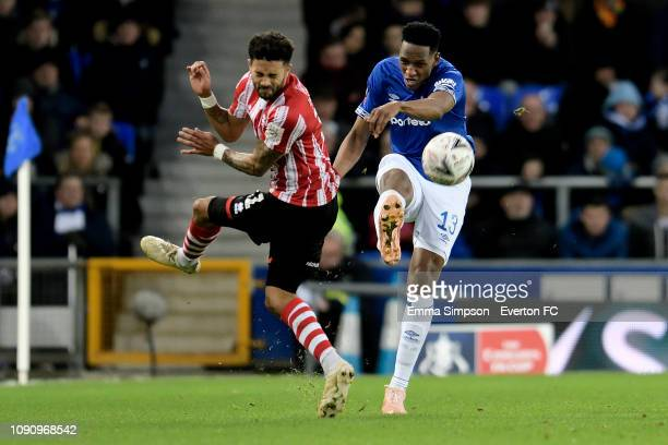 Yerry Mina of Everton and Bruno Andrade of Lincoln challenge for the ball during the Emirates FA Cup Third Round match between Everton and Lincoln...