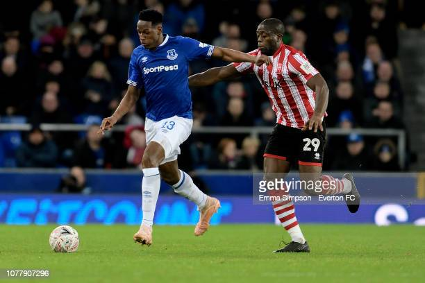 Yerry Mina of Everton and John Akinde challenge for the ball during the Emirates FA Cup Third Round match between Everton and Lincoln City at...