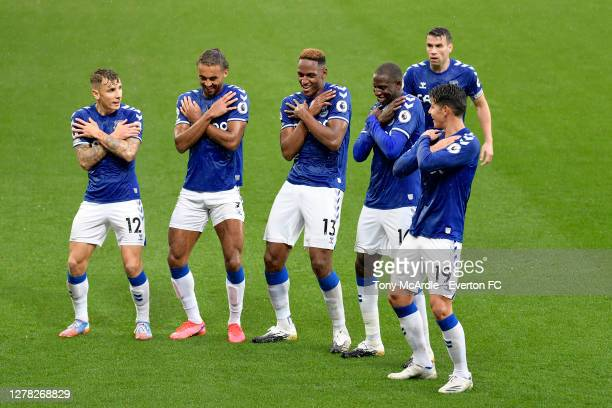 Yerry Mina of Everton celebrates his goal with Lucas Digne, Dominic Calvert-Lewin, Abdoulaye Doucoure, Seamus Coleman, and James Rodriguez during the...