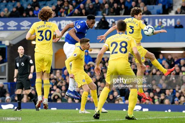 Yerry Mina of Everton powers a header during the Premier League match between Everton and Chelsea at Goodison Park on March 17 2019 in Liverpool...