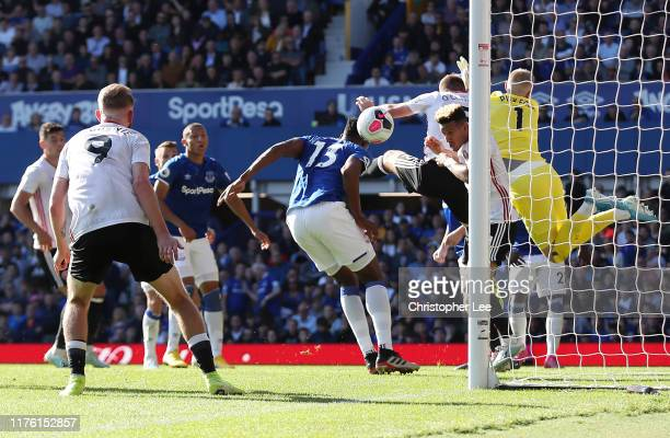 Yerry Mina of Everton scores an own goal for Sheffield United's first goal during the Premier League match between Everton FC and Sheffield United at...