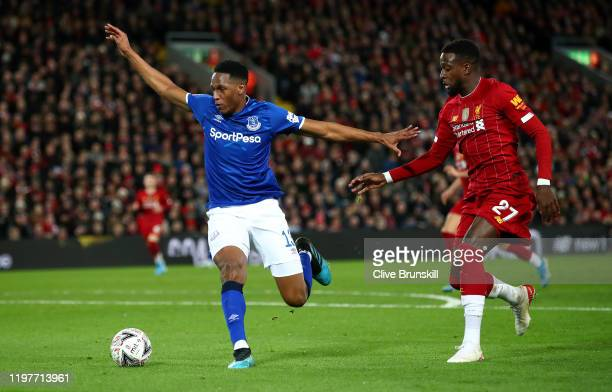Yerry Mina of Everton under pressure from Divock Origi of Liverpool during the FA Cup Third Round match between Liverpool FC and Everton FC at...