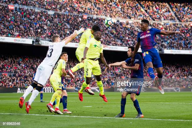 Yerry Mina of FC Barcelona heads for the ball during the La Liga match between Barcelona and Getafe at Camp Nou on February 11 2018 in Barcelona Spain