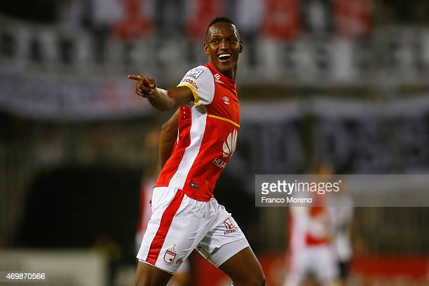 Yerry Mina of Independiente Santa Fe celebrates after scoring his team's third goal during a match between ColoColo and Independiente de Santa fe as...