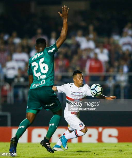 Yerry Mina of Palmeiras and Cueva of Sao Paulo in action during the match between Sao Paulo and Palmeiras for the Brasileirao Series A 2017 at...