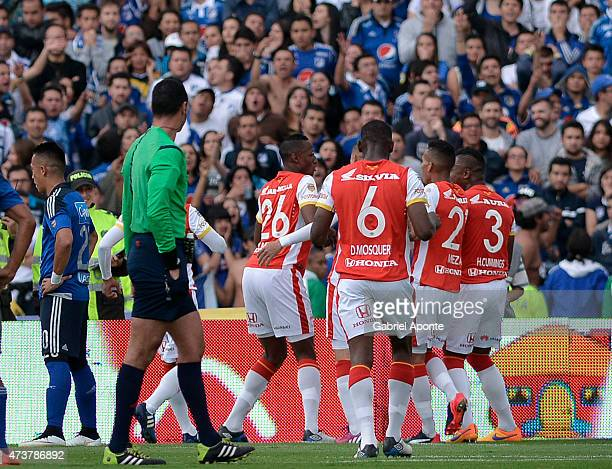 Yerry Mina of Santa Fe celebrates with teammates after scoring the opening goal during a match between Independiente Santa Fe and Millonarios as part...