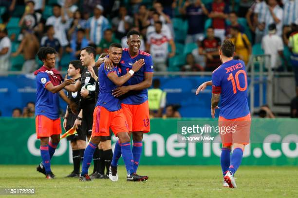 Yerry Mina William Tesillo and James Rodriguez of Colombia celebrates after winning the Copa America Brazil 2019 group B match between Argentina and...