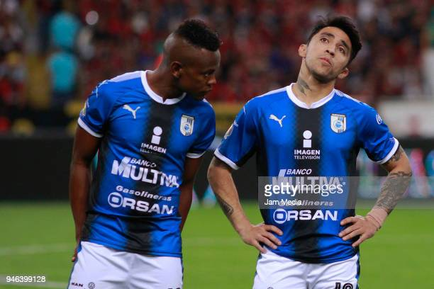 Yerson Candelo and Edson Puch of Queretaro gesture during the 15th round match between Atlas and Queretaro at Estadio Jalisco on April 13 2018 in...