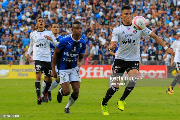 Yerson Candelo of Queretaro and Luis Reyes of Atlas fight for the ball during the 15th round match between Queretaro and Atlas as part of the Torneo...
