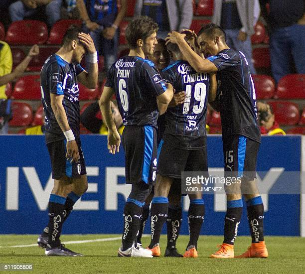 Yerson Candelo of Queretaro celebrates his goal with teammates during their CONCACAF Quarterfinals Champions League football match against DC United...