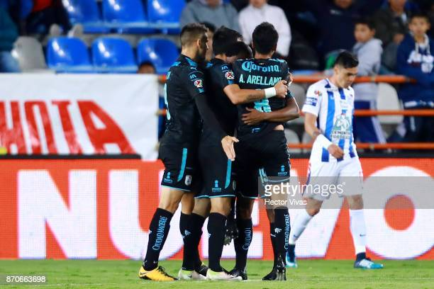 Yerson Candelo of Queretaro celebrates with teammates after scoring the first goal of his team during the 16th round match between Pachuca and...