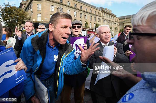 Yes and Better Together supporters exchange views with one another as Jim Murphy Shadow Secretary of State for International Development speaks on...