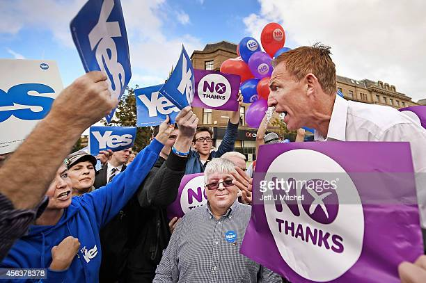 Yes and Better Together supporters listen to Jim Murphy Shadow Secretary of State for International Development speaking on his soapbox during his...