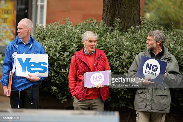 Yes and No campaigners canvass outside Church Hill Theatre polling station during the Scottish referendum on September 18 2014 in Edinburgh Scotland...