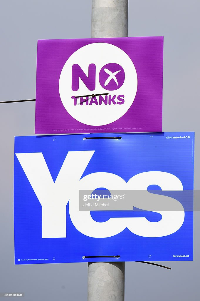 Yes and No placards are tied to a lamppost outside the Blantyre Miners Welfare club where Labour Leader Ed Miliband, gave a speach on the Scottish independence referendum on September 4, 2014 in Blantyre,Scotland. Miliband urged Scots to reject independence in a referendum on the 18th of September, promising he will win a national election next year and give them the changes they crave.