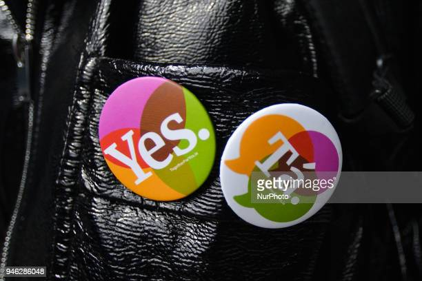 Yes and Ta badges from Together for Yes seen on one of many activists attending a Rally for Equality Freedom amp Choice organised by ROSA an Irish...