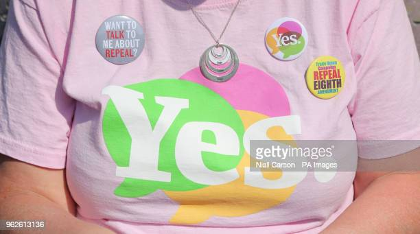Yes badges on the TShirt of Liz Crummie as the result is announced at Dublin Castle in the referendum on the 8th Amendment of the Irish Constitution...