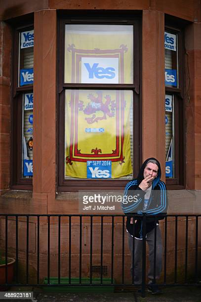 Yes campaign supporter SITV Tam from Govan smokes outside his tenement flat on May 9 2014 in Glasgow ScotlandA referendum on whether Scotland should...