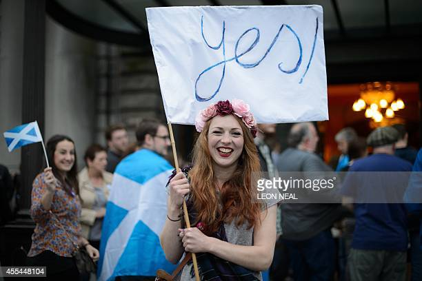 'Yes' campaign supporter waves a flag outside Usher Hall ahead of the 'A Night for Scotland' concert in Edinburgh Scotland on September 14 2014...