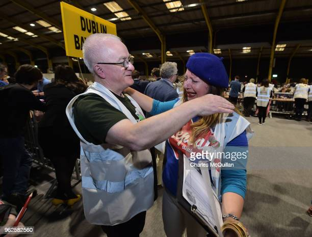 Yes campaigner breaks down in tears and is hugged as the count in the Irish referendum on the 8th amendment concerning the country's abortion laws...