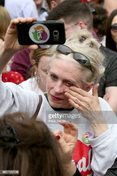 A Yes campaigner weeps as she waits for the official result of the Irish abortion referendum at Dublin Castle in Dublin on May 26 2018 Irish Prime...