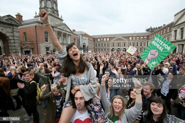 'Yes' campaigners celebrate the official result of the Irish abortion referendum at Dublin Castle in Dublin on May 26 2018 which showed a landslide...