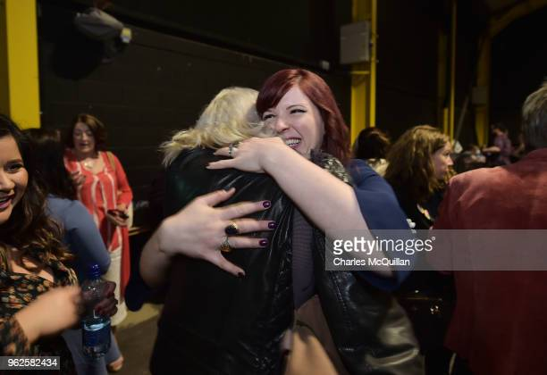 Yes campaigners hug one another as the count in the Irish referendum on the 8th amendment concerning the country's abortion laws takes place at the...