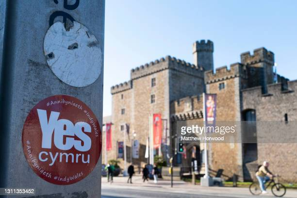 Yes Cymru sticker, in support of Welsh independence, in front of Cardiff Castle on March 16, 2021 in Cardiff, Wales. The 2021 Senedd election will be...