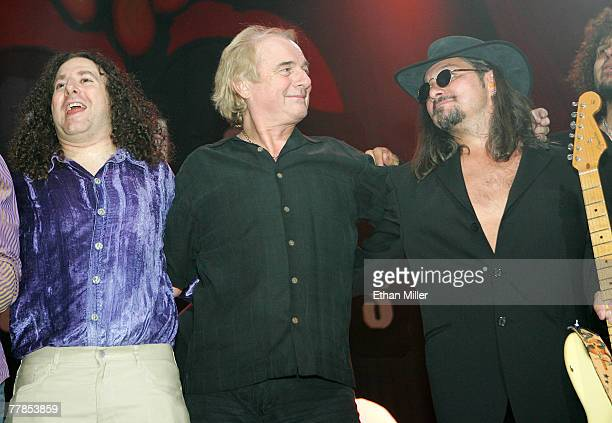 Yes drummer Alan White takes a bow with campers Michael Bluejay and Eric Herbst after performing during the Rock 'n' Roll Fantasy Camp's 10th...