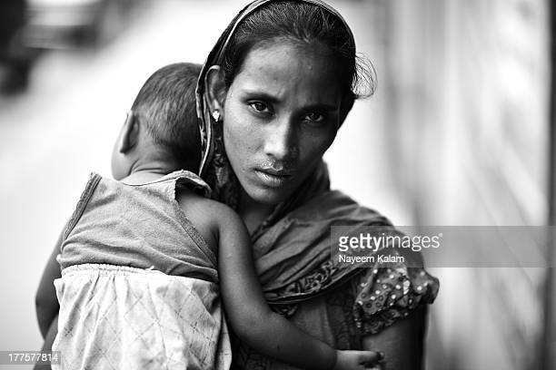 CONTENT] Yes her name is Baby thats what she said Another young beggar mother that I encountered outside in the streets near Laham's Kebab Laal Khan...