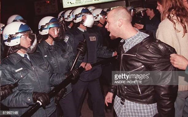 A yes supporter yells at police late 30 October in Montreal following the defeat of the yes vote by 4962 percent to the no vote with 5038 in a...