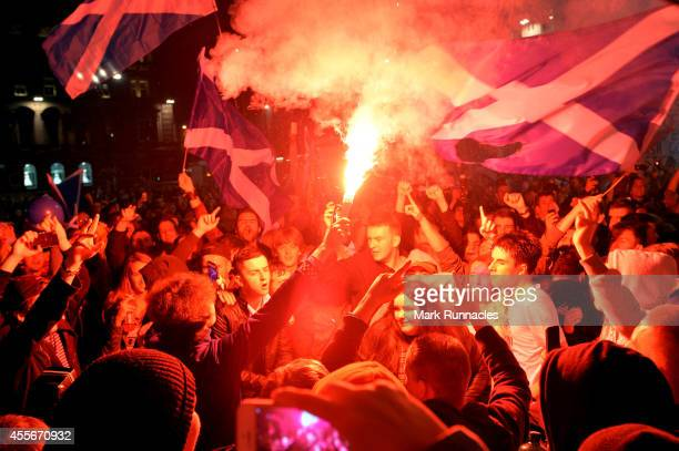 'Yes' Supporters burn flares as they react to the polls closing in George Square as Scotland awaits the results of the Scottish Independence...