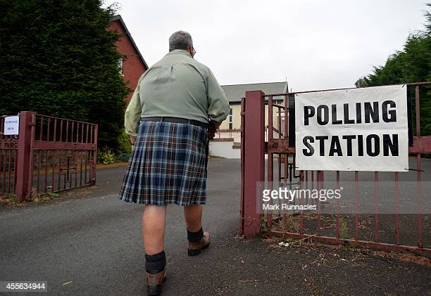 Yes voter Duncan Thomson waits for the doors to open at St Martins Church hall polling station as the people of Scotland take to the poles to decide...
