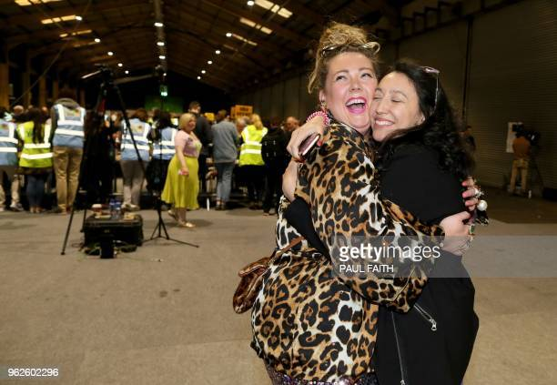 Yes voters Andrea Horan and Cara Sanquest embrace as votes are counted in the Irish abortion referendum at the RDS Conference centre in Dublin on May...