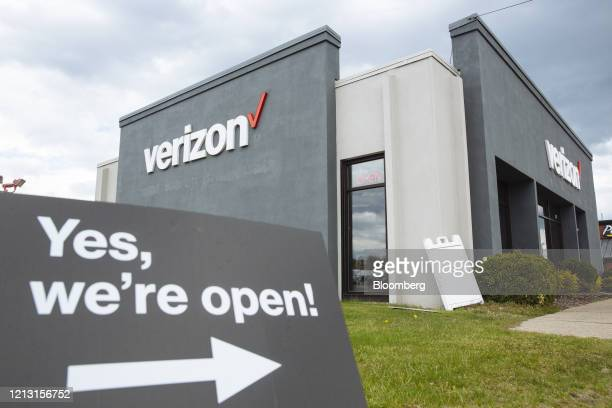 A Yes we're open sign is displayed outside a Verizon Communications Inc store in Johnstown New York US on Friday May 15 2020 With the spread of...
