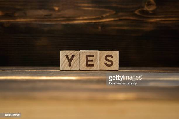 yes word on wooden blocks - spelling stock pictures, royalty-free photos & images