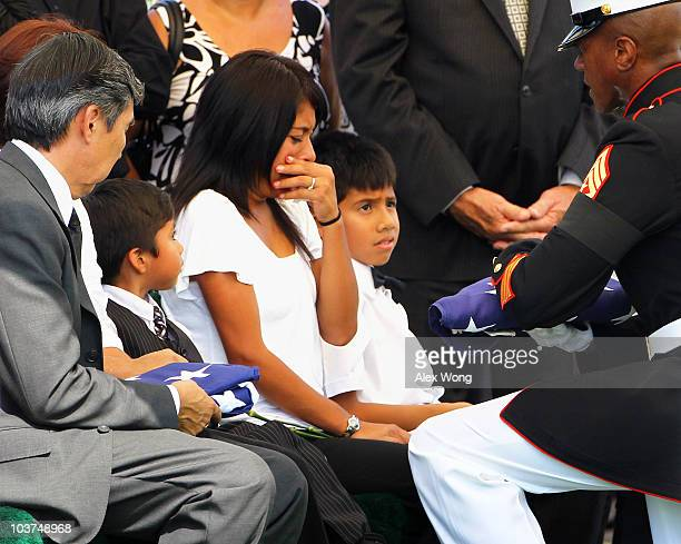 Yesenia Mendoza becomes emotional as Sgt Maj Eric Stockton presents her with the flag that covered the casket of her boyfriend US Marine Sgt Ronald A...